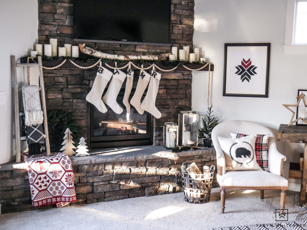 Simple scandinavian style Christmas decor ideas. Neutral mantel with simple features and pops of red and green,