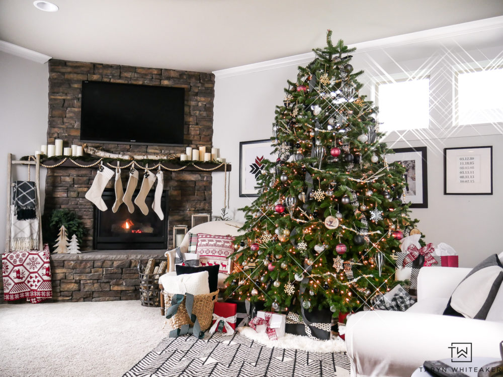 Rustic Modern Christmas Decor complete with Red, Black and White Christmas theme! The stone fireplace makes it so cozy.