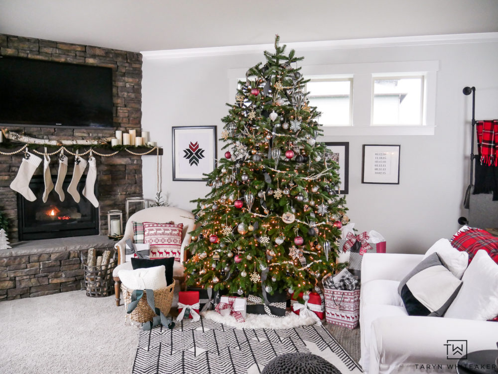 A red, black and White Scandinavian Christmas including large scale stone fireplace decked out for the holidays.