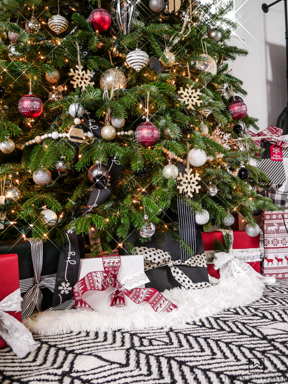 Red, black and white Christmas tree and gift wrap with modern black details.