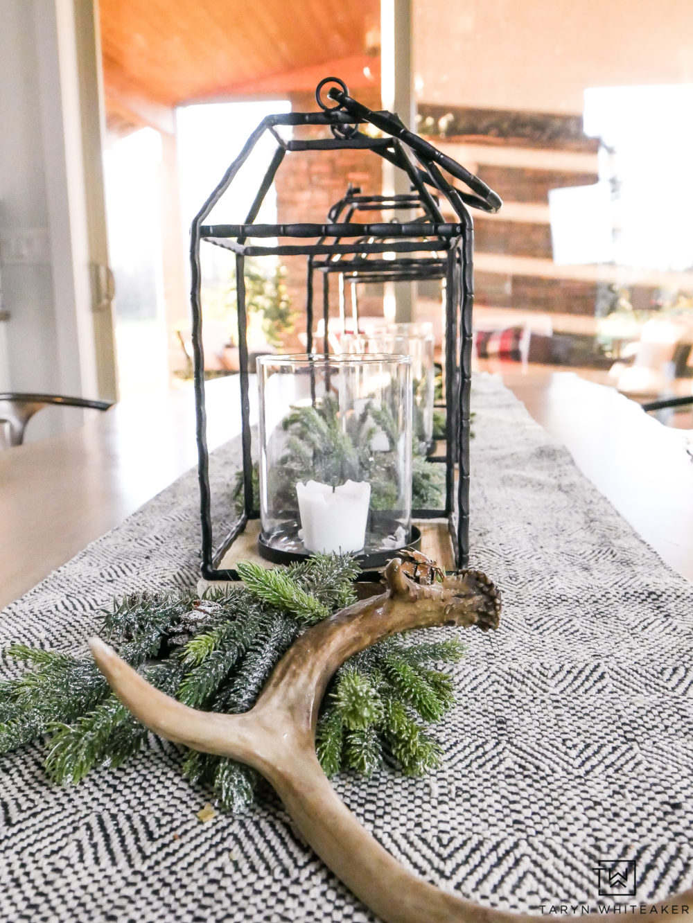 Black and White Christmas Centerpiece using lanterns and greenery