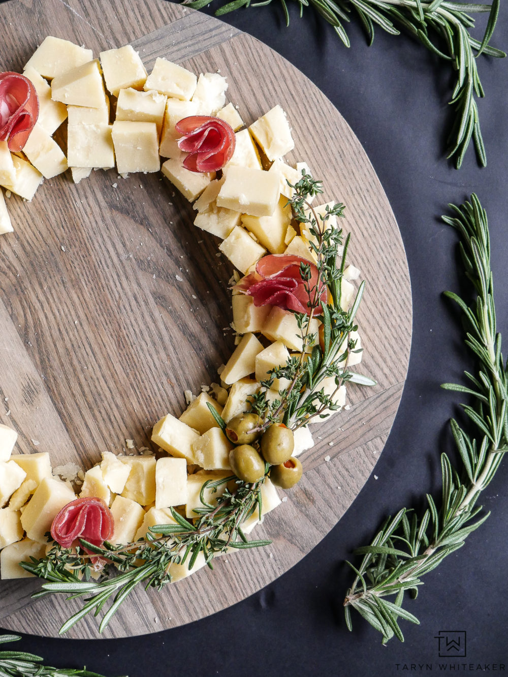 Impress your guests with the Christmas Wreath Cheese Board! Use fresh ingredients to create a beautiful presentation.