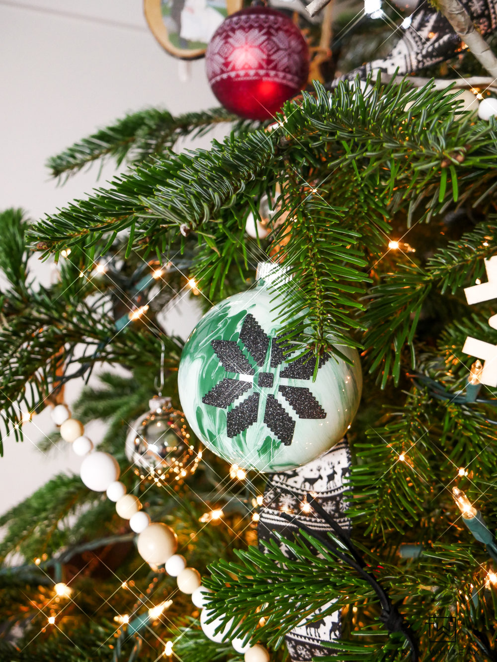 Green and White Marbled Glass Ornament with Nordic Snowflake Design,