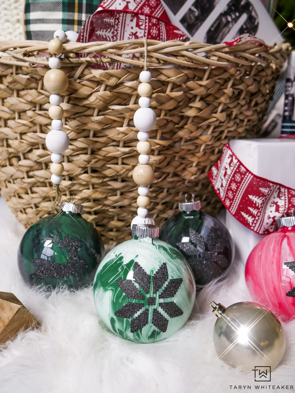 Love the DIY Marbled Ornaments! Personalize them with glitter vinyl designs, use Christmas symbols or even your name!