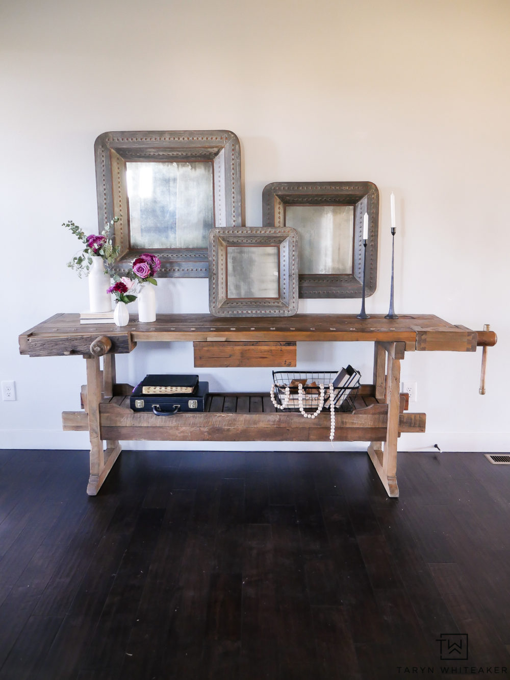 Love this spring entry way with the unique wood console table mixed with the large scale antique mirrors.