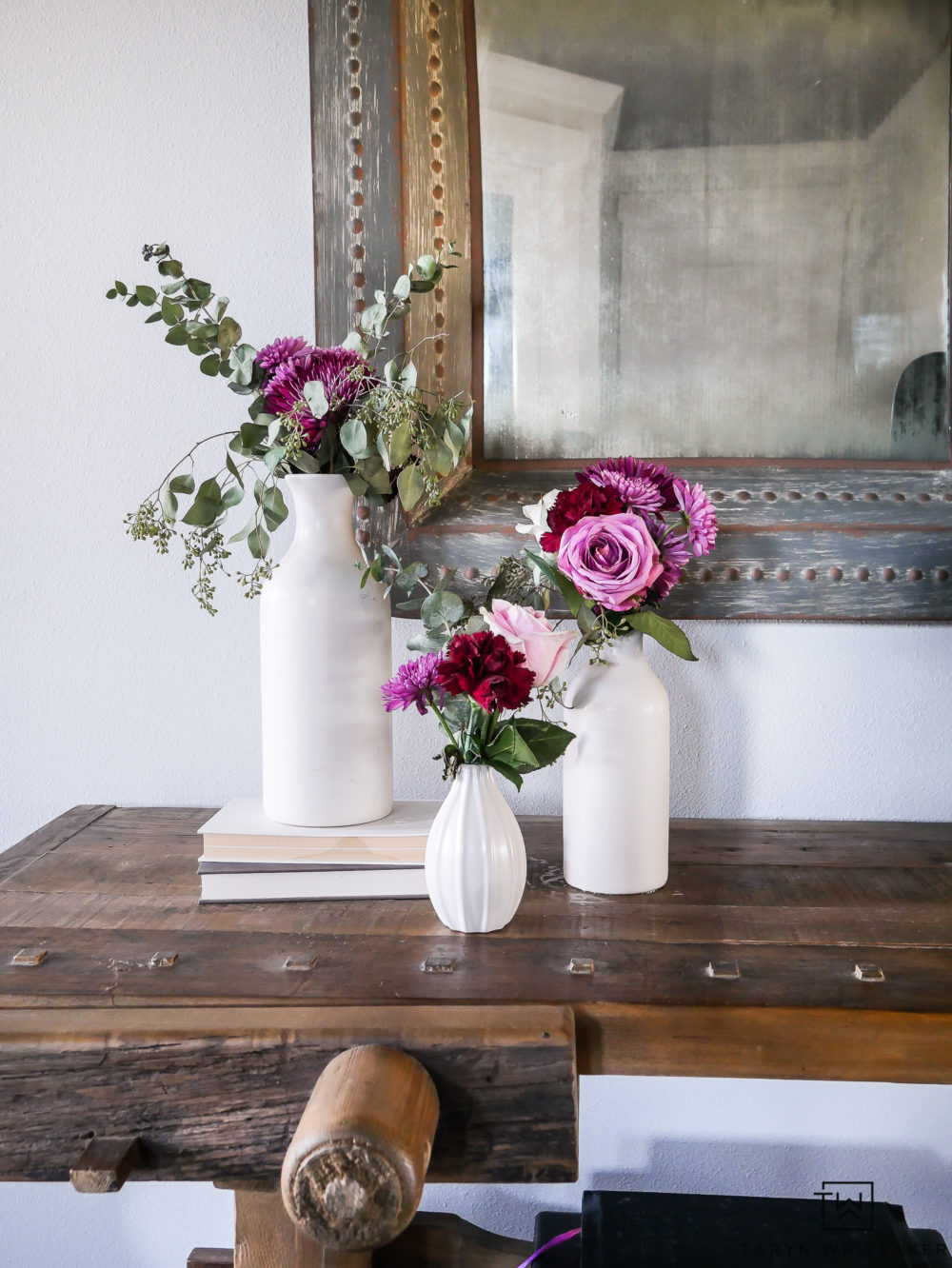 Create your own flower arrangements using flowers from the grocery store! they give every space such a breath of fresh air. Love decorating with fresh flowers!