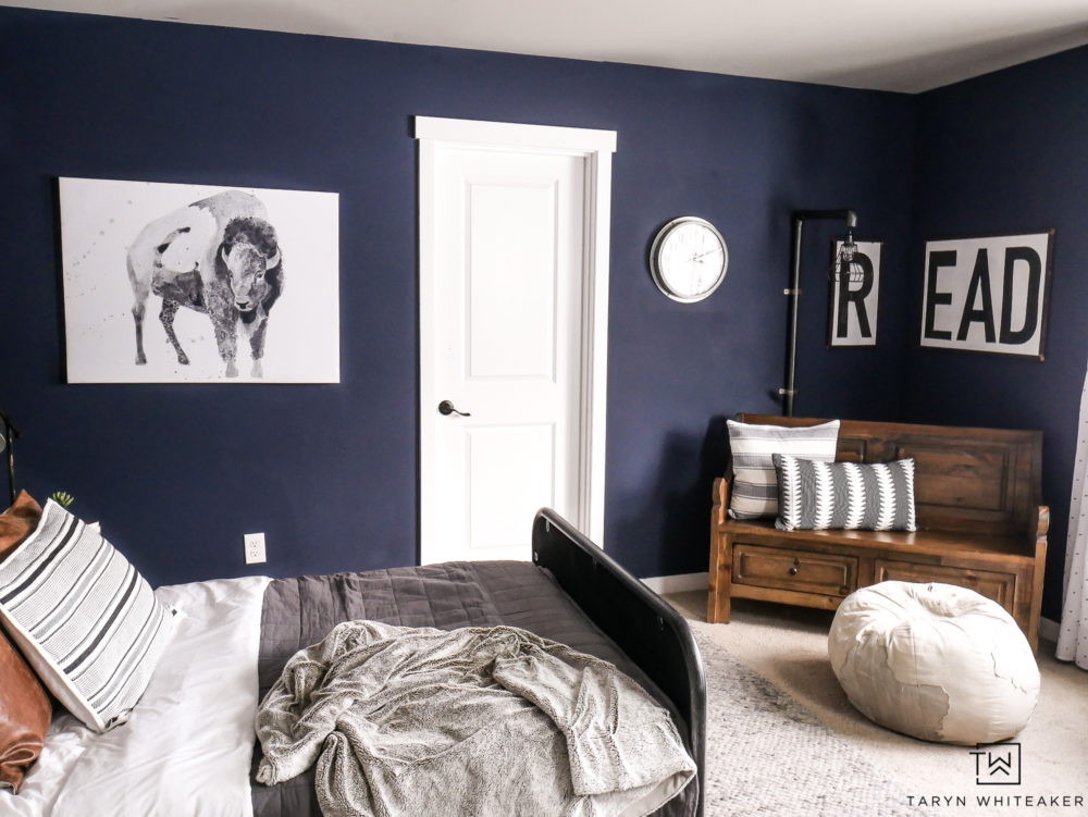 Navy blue boys room. Love the deep bold dark walls in this space!