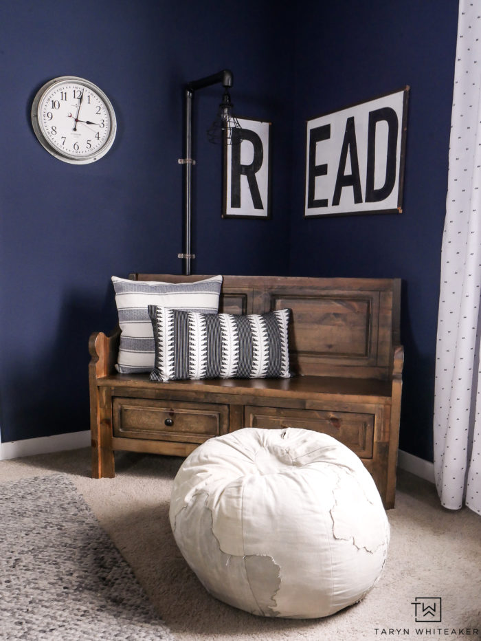 Navy blue modern farmhouse reading corner with church pew bench