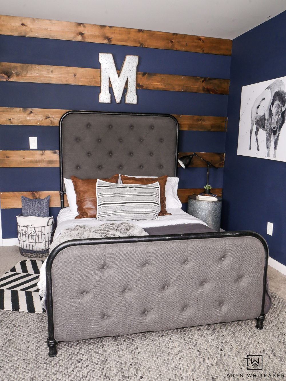 Love this rustic boy's room with dark navy walls, wood accents and unique touches.