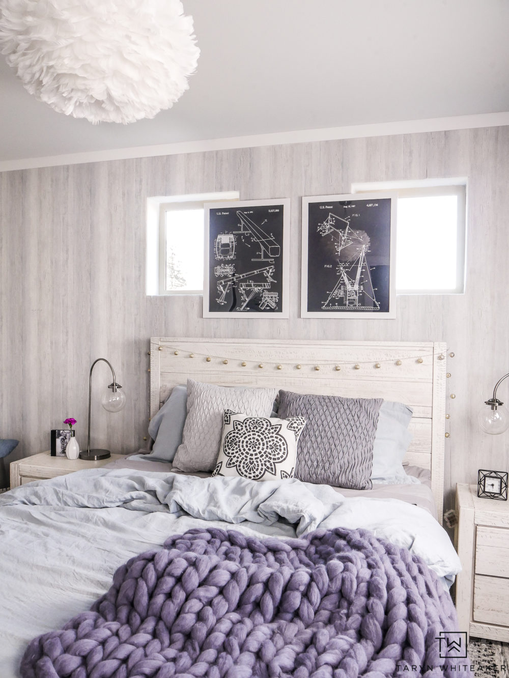 Modern boho girl's bedroom! Love all the soft texture and pops of blue. The textured wallpaper is such a great accent wall.