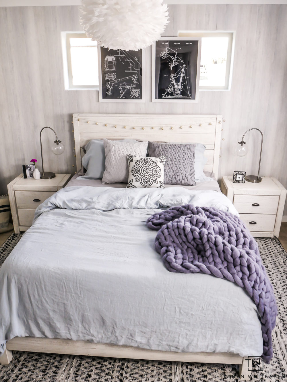 Modern boho girls bedroom with gray, black and white and pops of blue! Love the texture wallpaper and industrial touches.