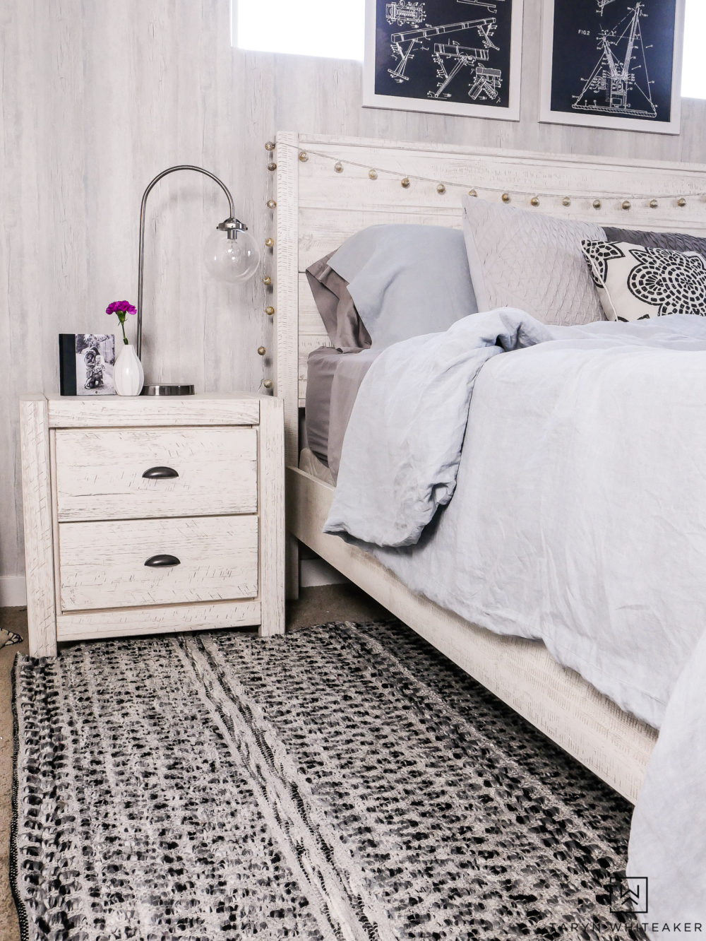 Black and white woven rug in modern boho girls room