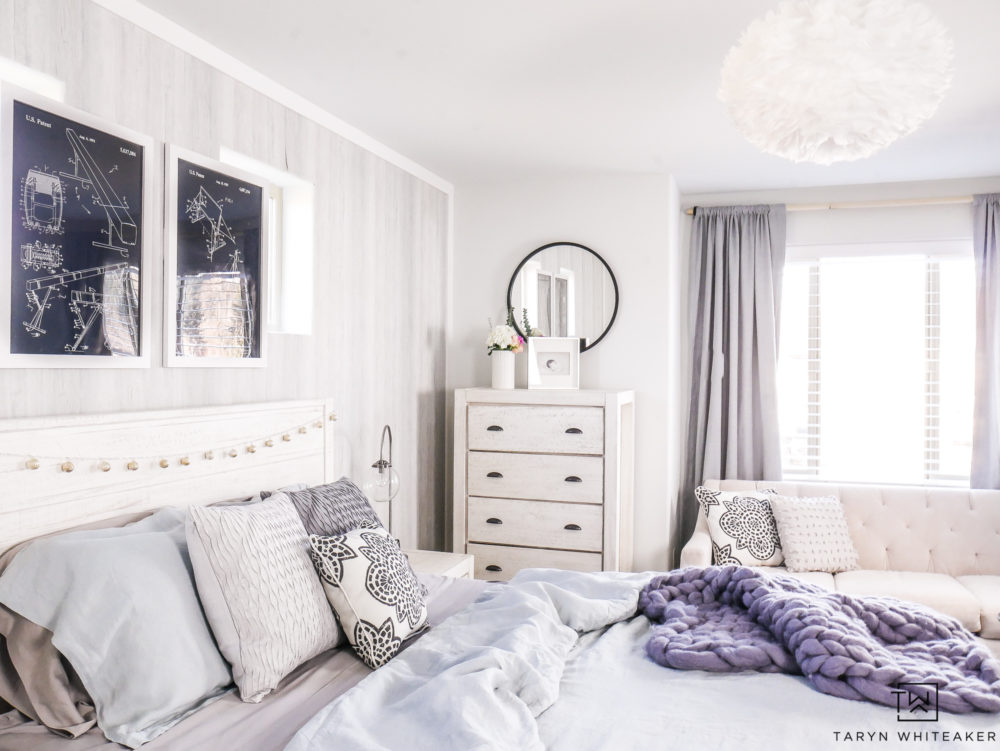 Boho Coast bedroom featuring soft grays and pops of blue!