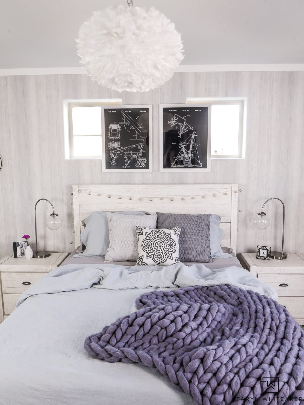 Tour this soft and cozy blue boho girls room! Filled with soft grays and pops of blue. Love the industrial touches.