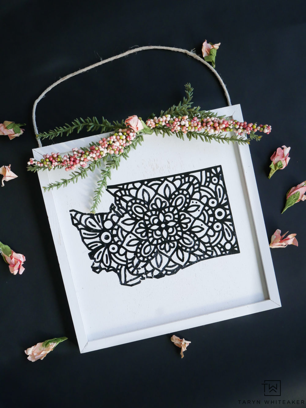 Learn how to make this adorable hanging state art! Fun for the wall or a unique spring wreath idea.