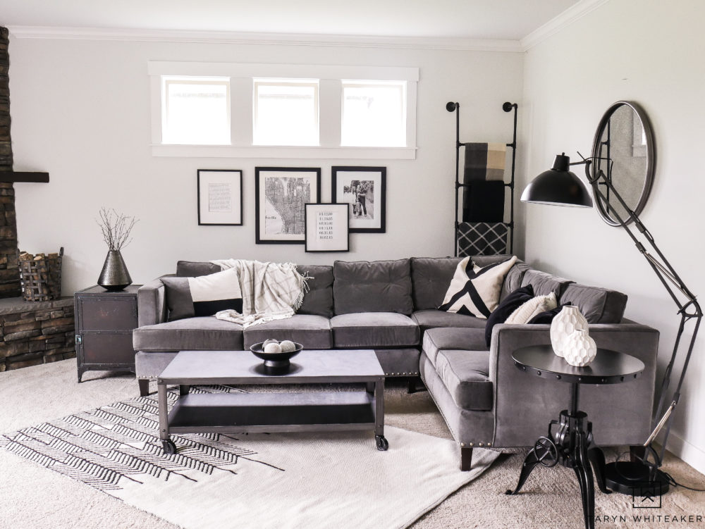Gray sectional with with black and white decor. Ideas for how to style a corner sectional.