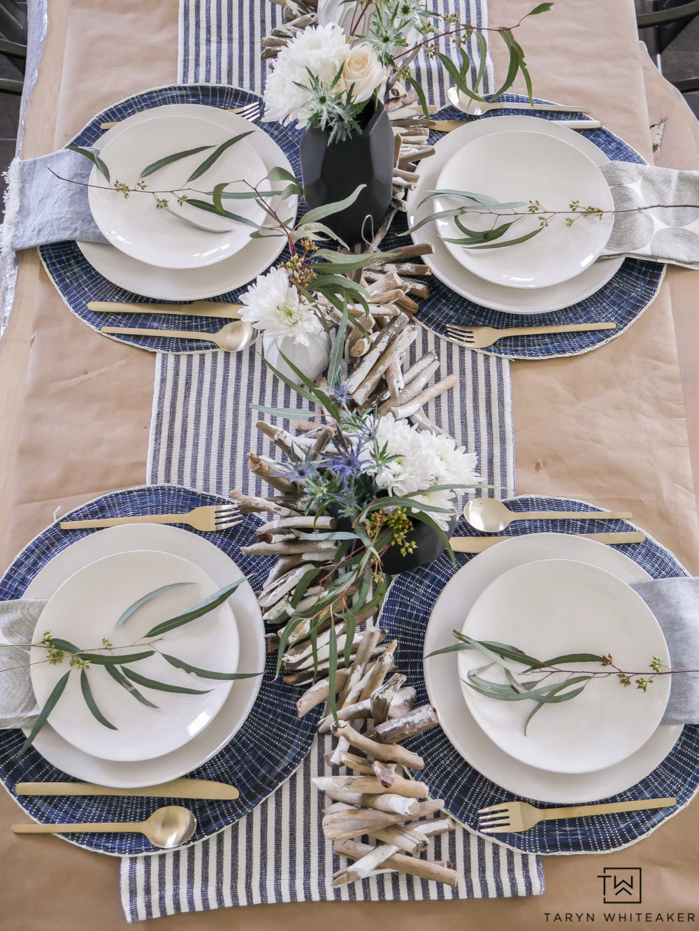 Simple and casual summer table decor featuring navy and white with pops of modern black accessories.