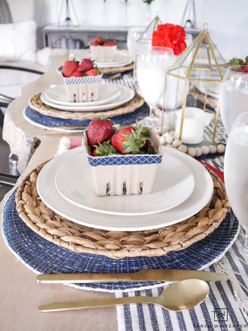 Perfect summer table setting with wicker, navy and fresh berries. The gold flatware is perfect in here.
