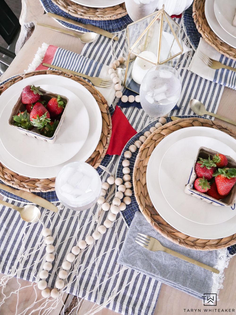 Fresh summer tablescape with nautical theme and fresh berries. Perfect for summer dinner decor!