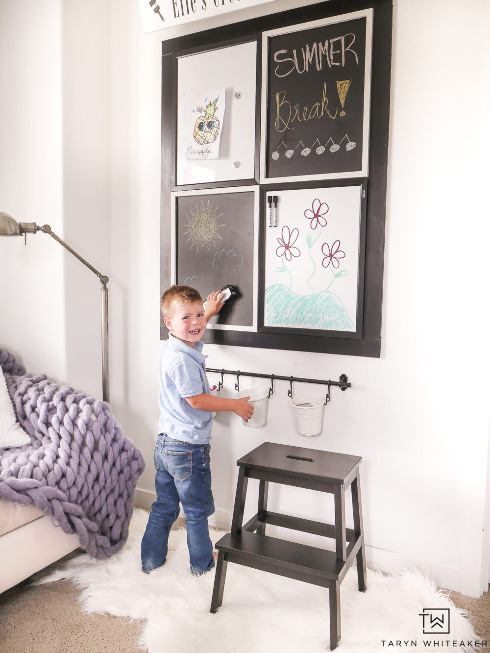 This kids art center is a great way to use up a large wall and also provide entertainment for the kids!