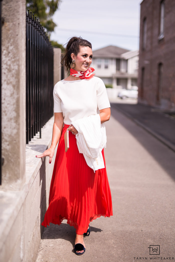 This summer is all about the midi skirt, this red pleated skirt is so cute for summer weddings and business meetings.