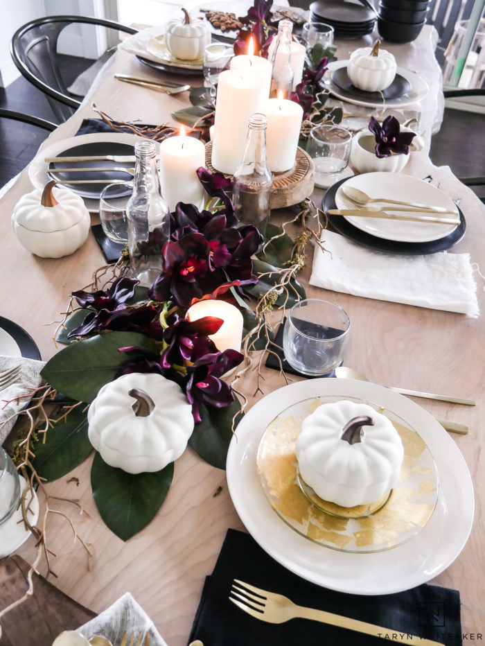 See all the details of this early fall tablescape with black and white fall decor and tons of deep earth tones. This plum fall table decor is so refreshing.