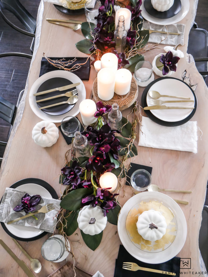 Eclectic fall table using black and white dishes and deep earth tone accents. Love the plum fall decor.
