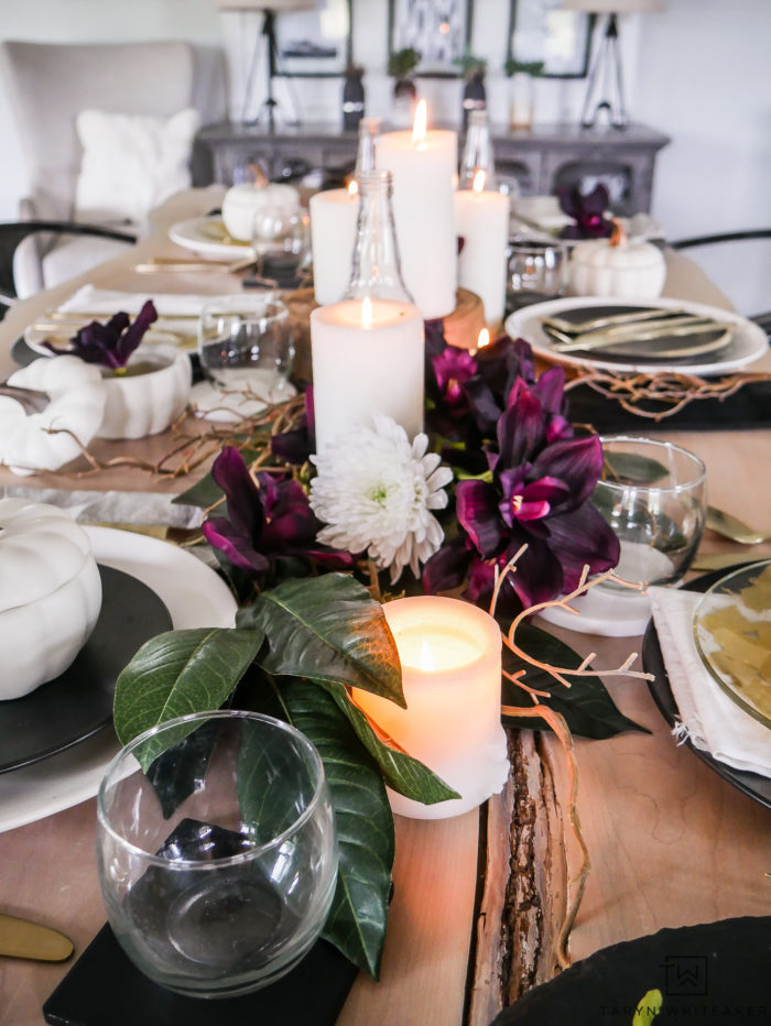 Plum fall table decor, with candles and twigs.