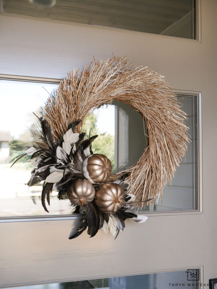 Learn how to make this 10 minute fall craft! This Feather Fall Wreath add some texture and festive flare to your door.