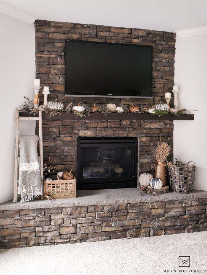 Create an elegant and natural fall mantel using neutral colors, pops of copper and natural fall textures. Love the pumpkin mantel display.