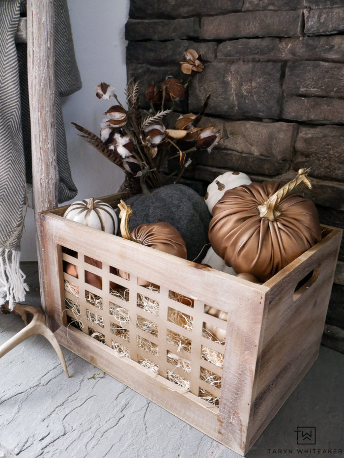 Crate with pumpkins and cotton stems inside!