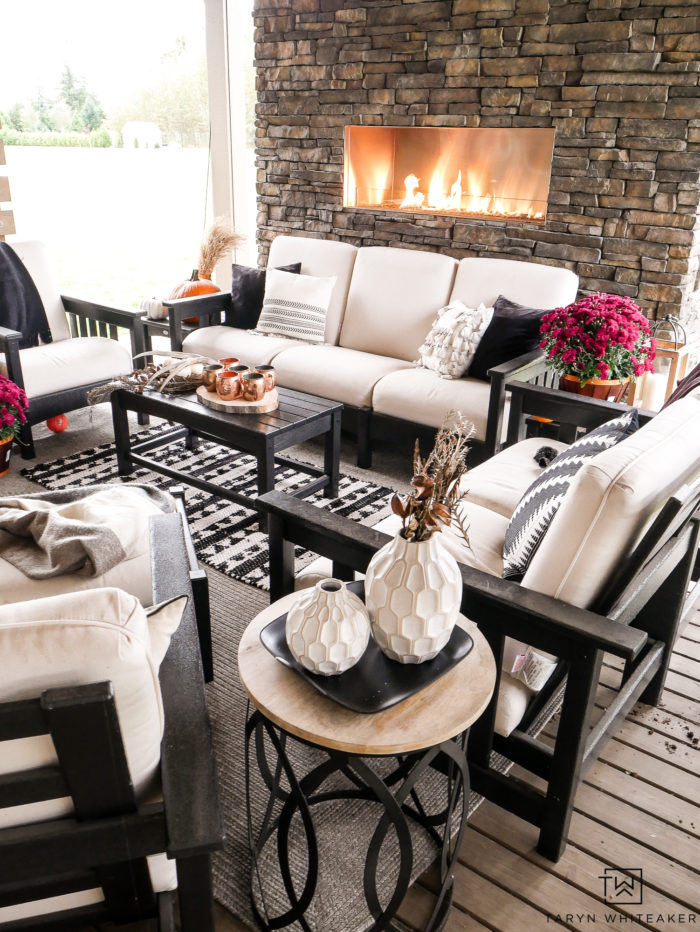 Learn how to turn your outdoor living space into a cozy fall escape using pumpkins, mums and plaid blankets. This outdoor fall decor is simple and inviting.