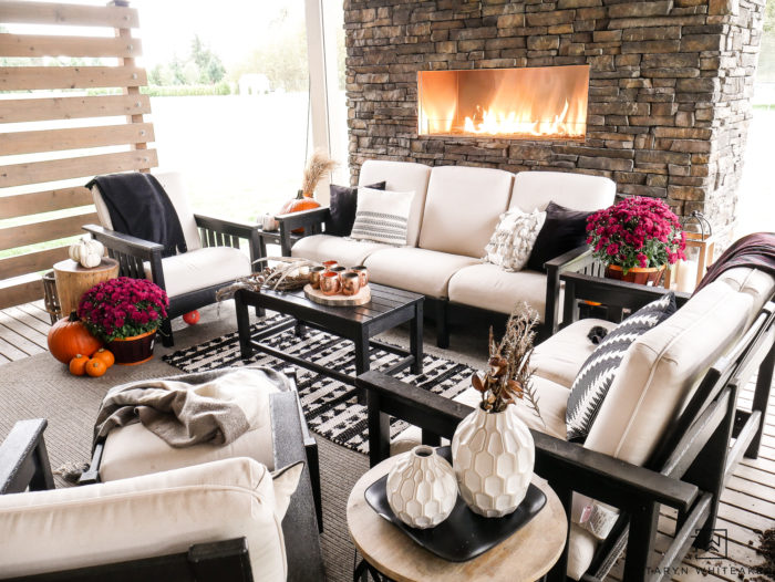 Modern outdoor living space decorated for fall.