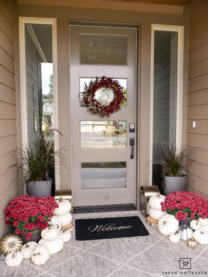 Classic and timeless fall porch with red mums, a red fall wreath and white pumpkins! Gorgeous Fall Porch Decor.