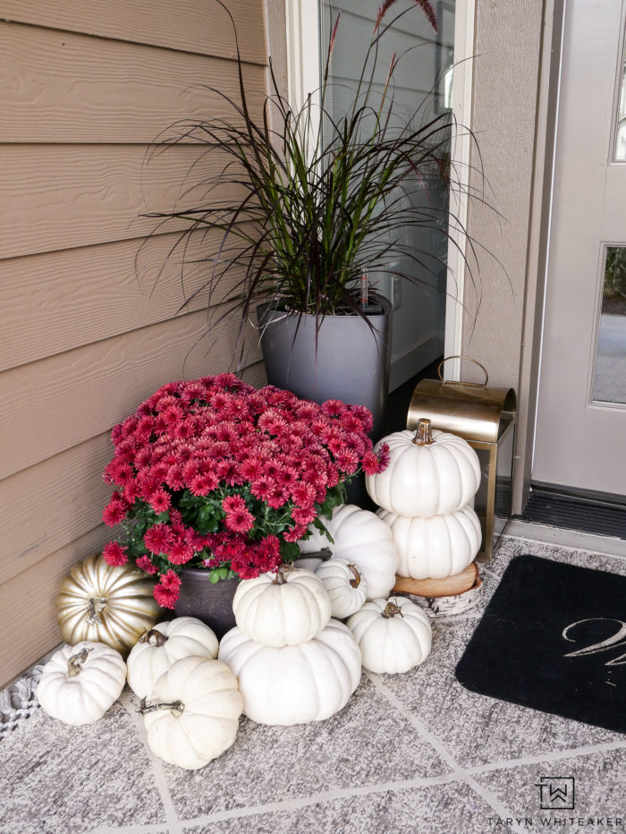 Red mums, white pumpkins, gold lanterns, what more could you want on a fall porch! Click to get the look.