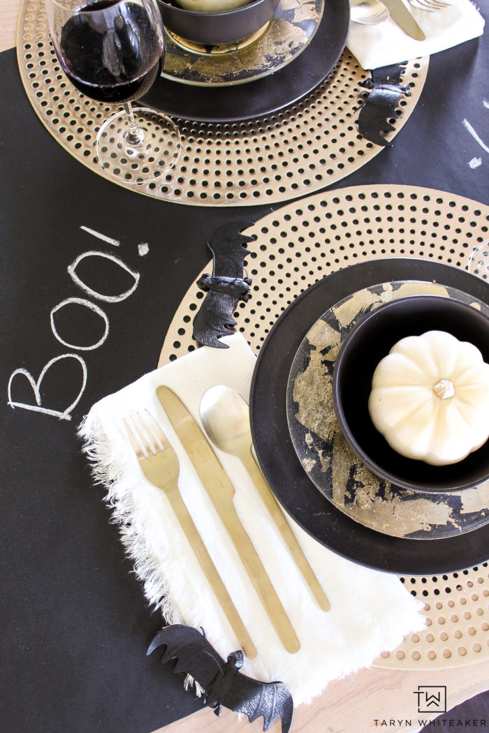 Adorable Halloween Tablescape featuring black packaging paper, chalkboard sayings and pops gold!
