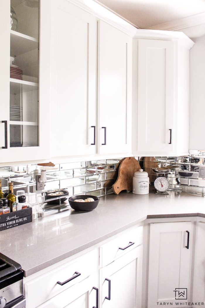 Black and White Modern Kitchen with mirror subway tile.