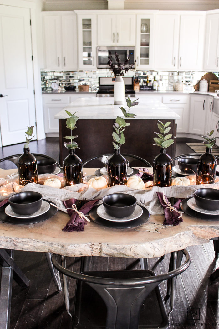 This black and plum fall table is perfect way to keep modern style but also dress your table for the holidays.