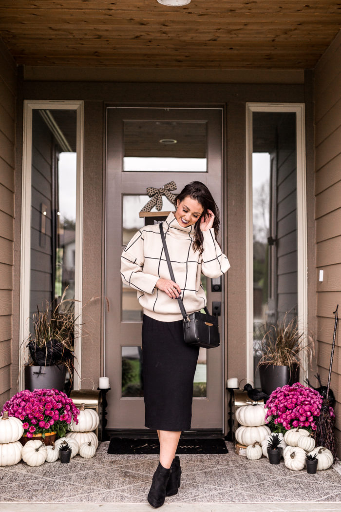 Loving this neutral and bold fall business casual outfit. From going to the office to heading to dinner pair an oversized sweater over a black midi dress.