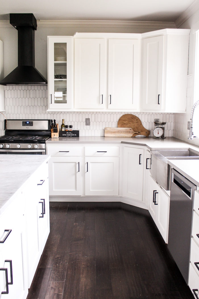 Black and white kitchen makeover! Changing out your cabinet pulls can make such a difference!