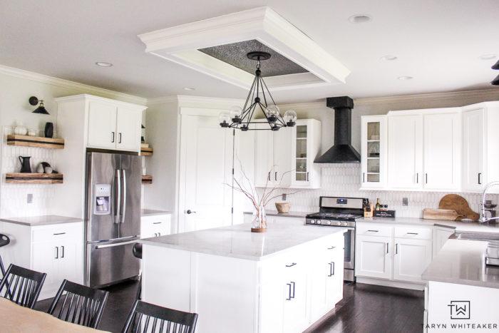 Black and White kitchen renovation. Love the sleek modern design and industrial kitchen decor.