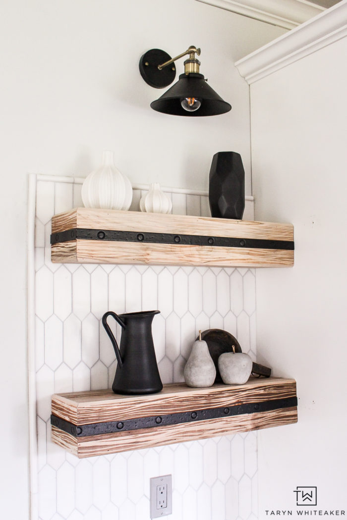 gorgeous rustic shelves against the white marble tile!