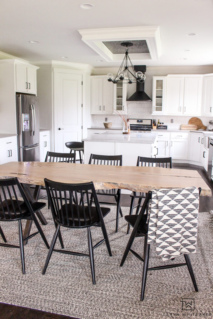 Black and white Scandinavian inspired kitchen design with natural wood accents and industrial touches.