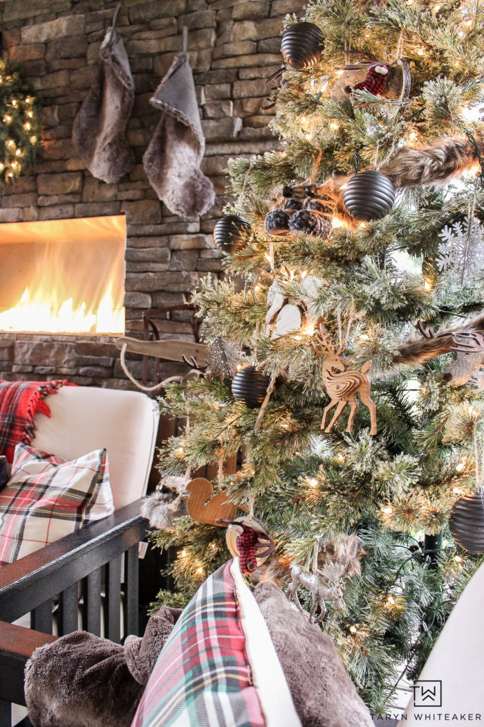 Learn how to get this cabin chic christmas look in your own home using a mixture of woodland christmas decor, tartan print and modern black accents!