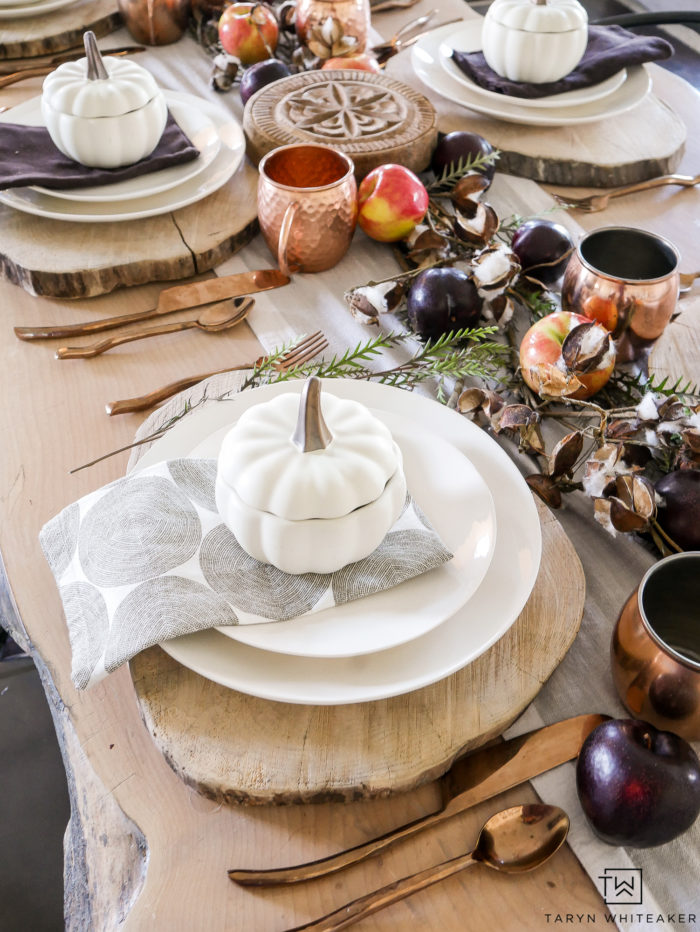 Beautiful earth tone thanksgiving tablescape using pumpkin tureens and fresh fruit centerpiece