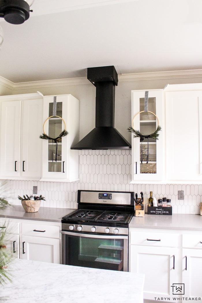 Wreaths handing over cabinets is a great way to add a little Christmas to your kitchen.