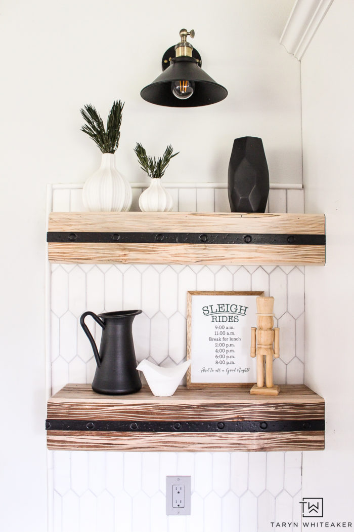 Decorate your open shelves in the kitchen for Christmas with a few new holiday signs and greenery!
