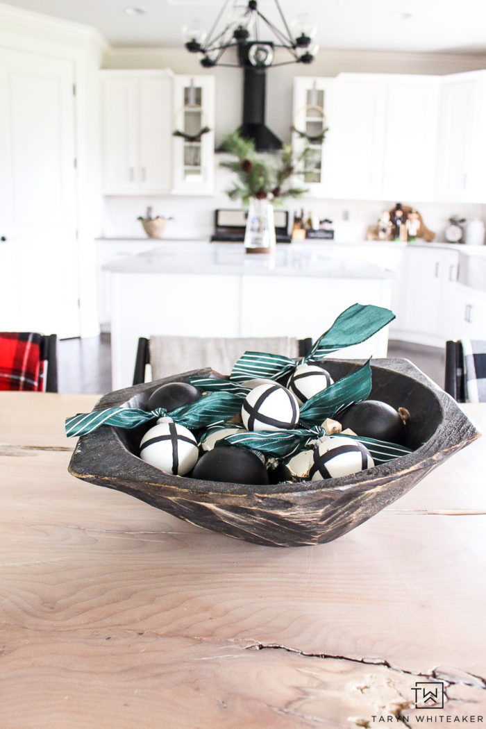 Placing ornaments in a big wooden bowl adds contrast and a nice touch of christmas in the kitchen.