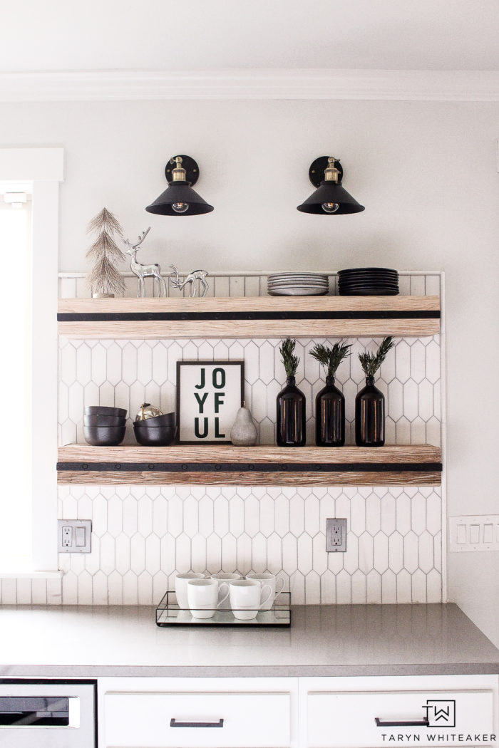 Modern farmhouse kitchen shelves all decorated for Christmas.