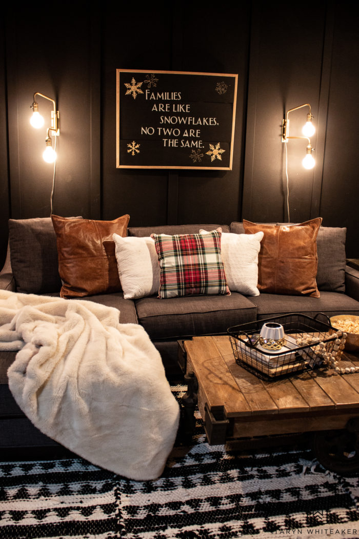 Learn how to make your own DIY Wood Snowflake sign with HART Tools from Walmart! Love how this rotary tool engraved the snowflakes into the sign. Looks great in this moody movie room with dark walls.